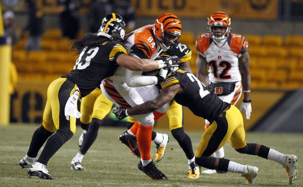 Ike Taylor Photos - Ike Taylor #24 and Troy Polamalu #43 of the Pittsburgh Steelers tackle Jermaine Gresham #84 of the Cincinnati Bengals during the game on December 15, 2013 at Heinz Field in Pittsburgh, Pennsylvania. - Cincinnati Bengals v Pittsburgh Steelers