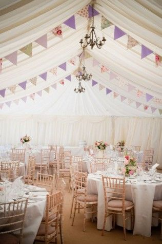 Bunting is a great way to 'personalise' a wedding marquee interior