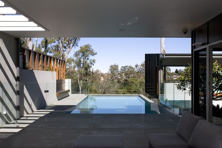 Fig Tree Pocket House 2: Outdoor pool seating area frames views onto surrounding tree tops. See more at http://blighgraham.com.au/projects/fig-tree-pocket-house-2