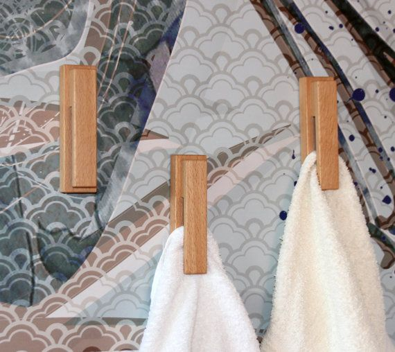 Wood towel hooks made of beautiful beech wood. Stylish accessoire to modern kitchen and bathroom. This magical towel holder is very special, but it is very easy to use. A traditional amish style towel rack revives in the modern everyday life. This listing contains 3 pcs of wood towel hook.  Features: - Made of natural beech wood. - A marble holds the towel in the rack. - Easy to use. - Natural, minimalist product. Enjoy the beauty of natural wood! - Finished with beewax. - Can be attached…