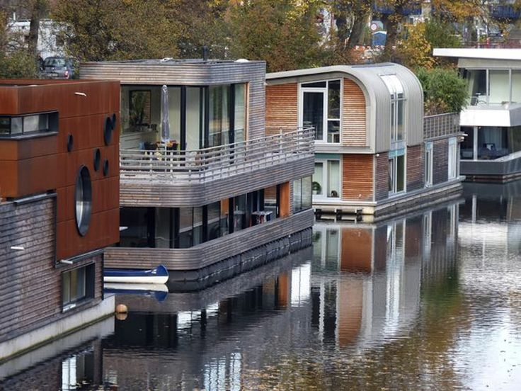 "In 2006, the city of Hamburg OK'd 10 moorings for houseboats for Germany's very 1st aquatic community. It's part of the ""Living & working on the water"" initiative that encourages German cities to use local waterways for urban development."