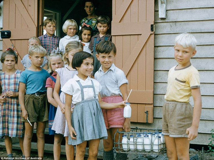 Children line up for milk at the migrant hostel in Scheyville, NSW in 1957. The migrant hostels were built on what had been the Scheyville Training Farm, where boys were trained in farm life