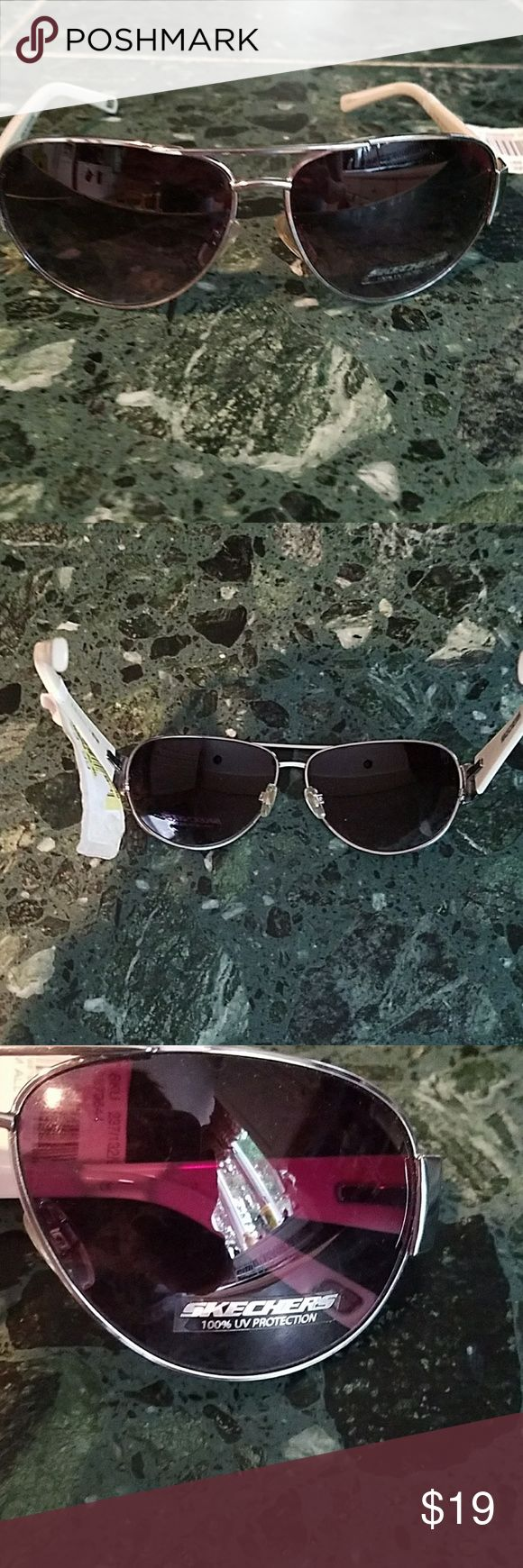 Sketchers sunglasses In good condition. Never used. Tiny scratches in lenses not bad at all. Tag a little old and ripped. Found in my closet. Skechers Accessories Glasses