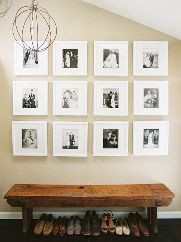 cute black and white framed family photos and wooden bench