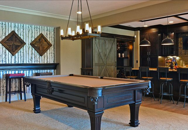 Basement Design. Great basement design. This basement is perfect for entertaining with a pool table, a theater, and seating area around the fireplace and a basement bar. #Basement #BasementIdeas