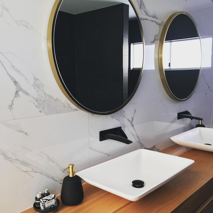 Beautiful large format tiles by @lifestyle.tiling = DELIS H H H H #tiles #westelm #stone #timber #design #interiordesign #carrara #phoenixtapware #roundmirror #brassmirror