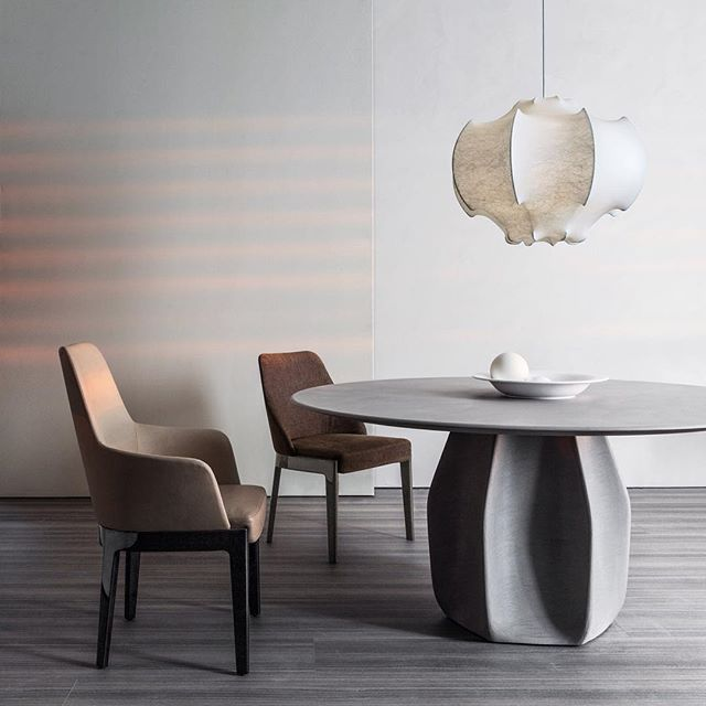 WEBSTA @ moltenidada - Contemporary #materials for two statement pieces. Asterias table design @patricia_urquiola in grey cement grout finish and Chelsea chair design #RodolfoDordoni in the new glossy lacquered finish for the legs.