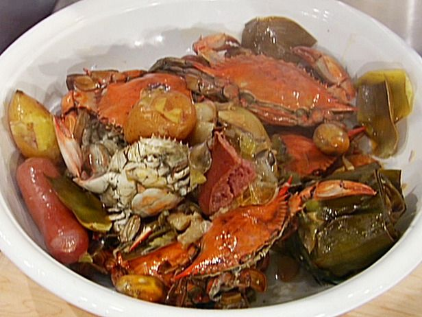 Crab, Potatoes, sausages, shrimp, corn on the cob and bread to sop up that good liquid!