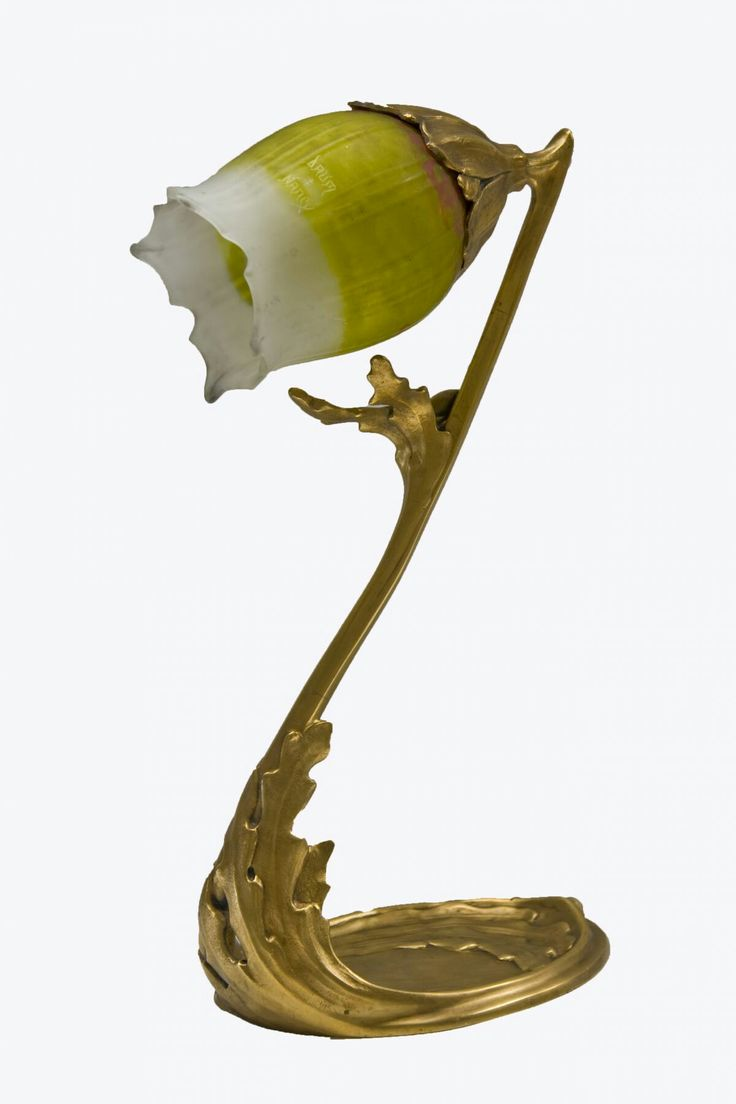 "A French Art Nouveau gilt-bronze ""Algae"" desk lamp decorated with a ""Daum Nancy"" glass shade. The base decorated in the algae pattern is attributed to Maurice Dufrene. The shade is signed, ""Daum Nancy""."