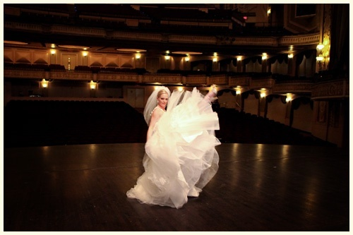 Ballet dancer bride on a familiar stage in an orpheum. Just asked her to dance.
