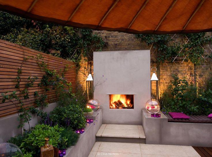 Urban Fireside Garden Contemporary Garden With Fireplace Lit At Night