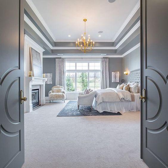 Whimsicla master bedroom with beautiful golden chandelier