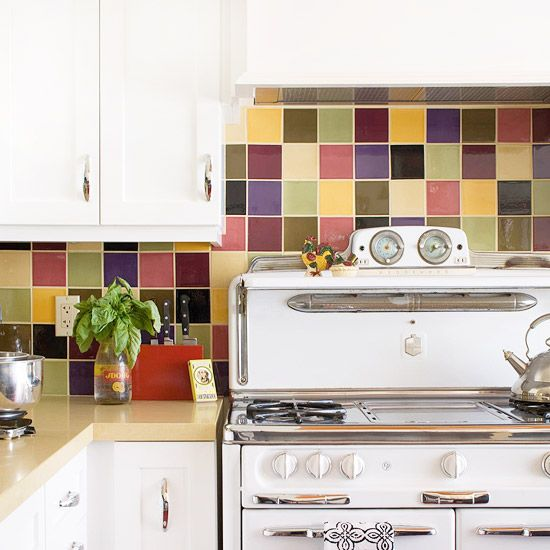 This colorful back splash it delightful.  I would probably use more greys and blues and would substitute red for the mauve.  It would make the room look like just plain fun and since being in the kitchen isn't always my favorite place to be this would be a great addition!