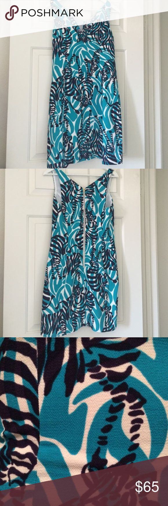 "Lilly Pulitzer ""I'm Game"" Zebra Dress Size 0 Excellent used condition! The Madeline sleeveless fit and flare dress brings a whole new meaning to fun party dresses. Fit and flare flatters your figure and this print is a conversation starter for sure. Excuse me miss, is that a zebra on your dress? YES!  Sleeveless Dress With Deep Notch And Center Back Exposed Zipper.  19"" From Natural Waist To Hem.  Lightweight Crepe - Printed (100% Polyester). Lilly Pulitzer Dresses Mini"