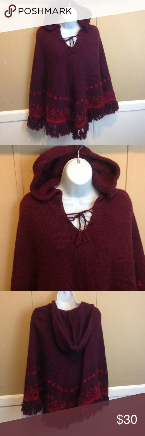"""American Eagle Wool Hooded Shawl Maker: American Eagle Outiftters ♥ Material: Shetland Wool ♥ Color: Burgundy ♥ Measured Size: Pit to pit- n/a Pit to cuff- n/a Shoulder to waist-  30""""  ♥ Tag Size:  S/M ♥ Actual Size: S/M PLEASE CHECK YOUR ACTUAL MEASUREMENTS TO MAKE SURE IT IS THE RIGHT SIZE! THANKS! ♥ Condition: Great Used Condition  ♥ Item #: (office use only) F  Follow us on Instagram and facebook for coupon codes!  INSTAGRAM-thehausofvintage1984 Facebook- intergalactic haus of vintage…"""