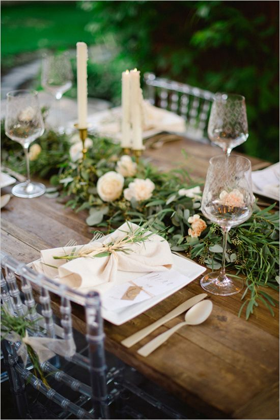 rustic wood table with greenery swag runner