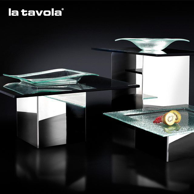 Risers in silver titanium finish with hardened smoked glass tops are an elegant…
