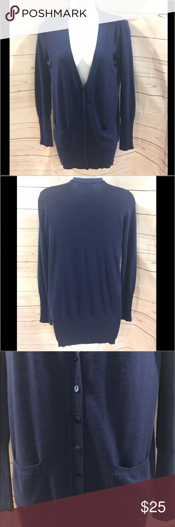 "Zara cardigan Zara cardigan.  Royal blue button down cardigan.  Bottoms on sides of arms, 2 front pockets.  Rayon/nylon/elastane. EUC. No flaws.  28"" long, 17"" across chest.  Item #1502 Zara Sweaters Cardigans"