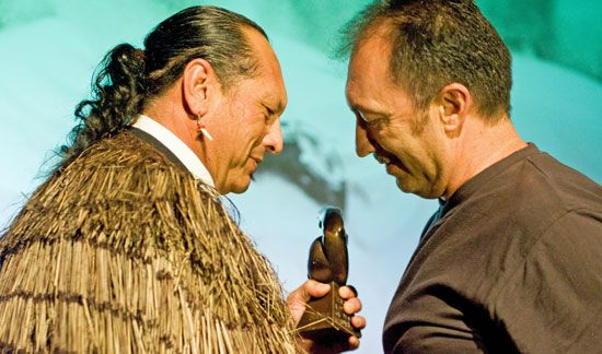 Lyonel Grant accepts his Laureate Award from Derek Lardelli at the Auckland ASB Events Centre,  Auckland in 2009.  The Laureate Award comes with a cheque for $50,000 and a Terry Stringer statuette. Image by Ken Baker