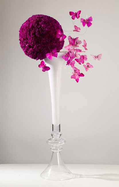 Floral arrangement with butterfly accessories - Repinned by Expressions Floral Design Studio #Columbus Florist