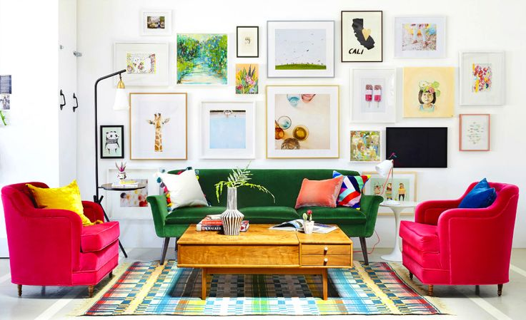 Green sofa and pink armchairs in vibrant living room