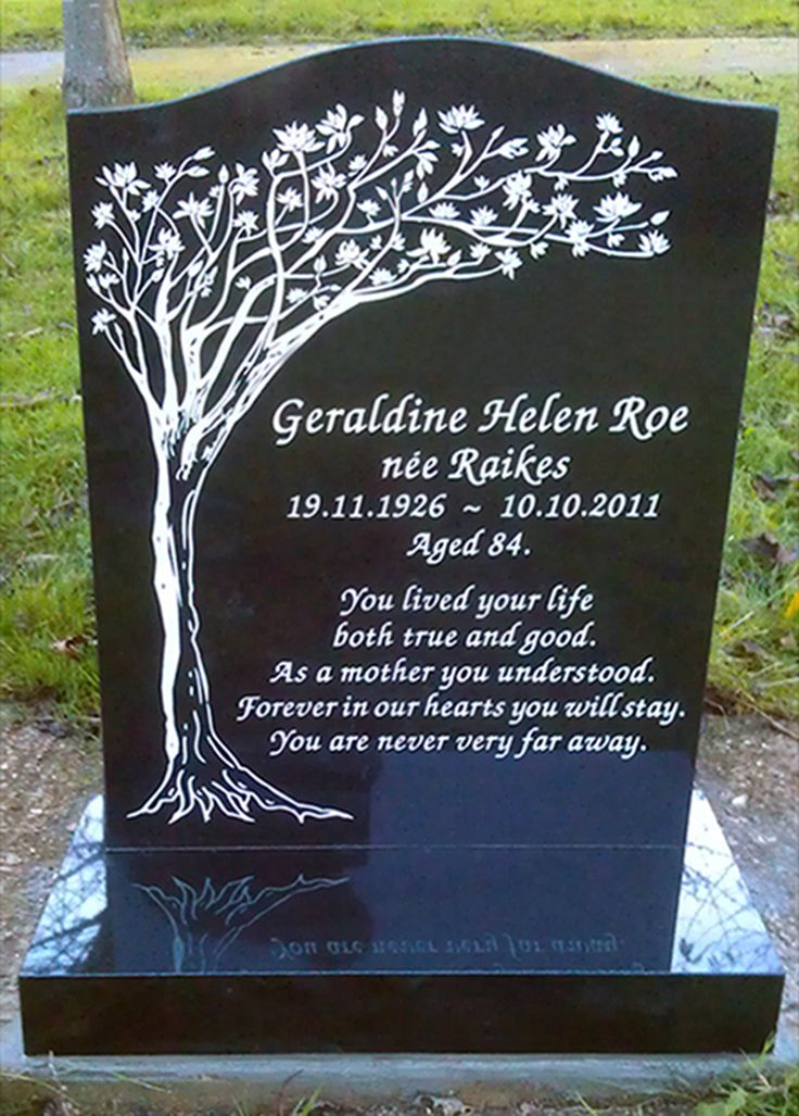 Tree themed memorial - a unique design by stonemason Andy Manuell. White enamel inscription on an all polished ogee-top Black Granite headstone and base. www.andymanuellstonemasons.co.uk