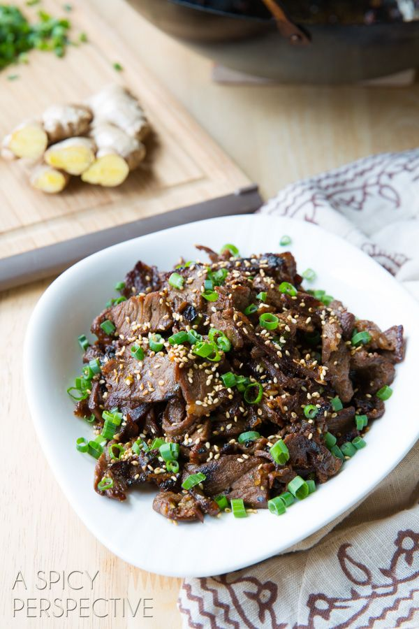 Bulgogi: Korean BBQ Beef #Asian #Recipe1 1/2 lbs. lean steak, frozen (I used New York Strips) 1/3 cup soy sauce 2 1/2 Tb. brown sugar 2 Tb. sesame oil 3 cloves garlic, minced 1 Tb. fresh grated ginger 1 bunch green onions, chopped, whites and greens separated 1/2 tsp. ground black pepper 1 tsp. sriracha (or kochujang Korean chile paste) 1 Tb. toasted sesame seeds