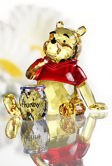 Lovable, cute and friendly, Winnie the Pooh sparkles in Light Topaz crystal with a vibrant Light Siam crystal shirt. He comes with a Light Sapphire...