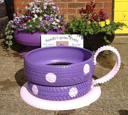 Tea cup planter made from old tires - OMG! What can't you do with a can of spray paint!