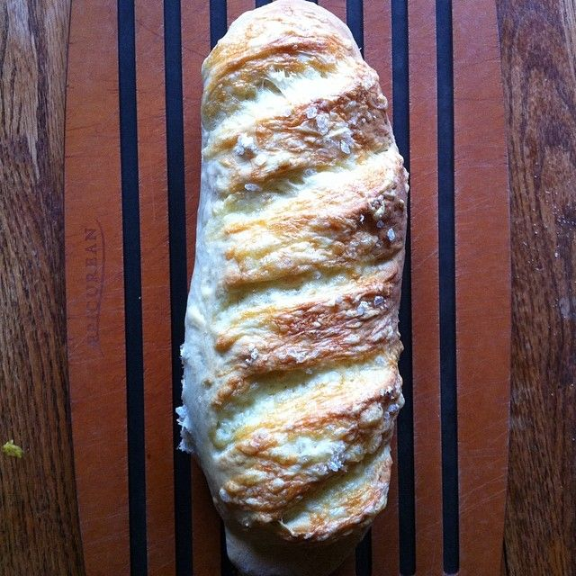 Mm. Cheese bread. #homemadebread #cdncheese #simplepleasures  French dough, topped with a GENEROUS helping of cheese & rock salt.