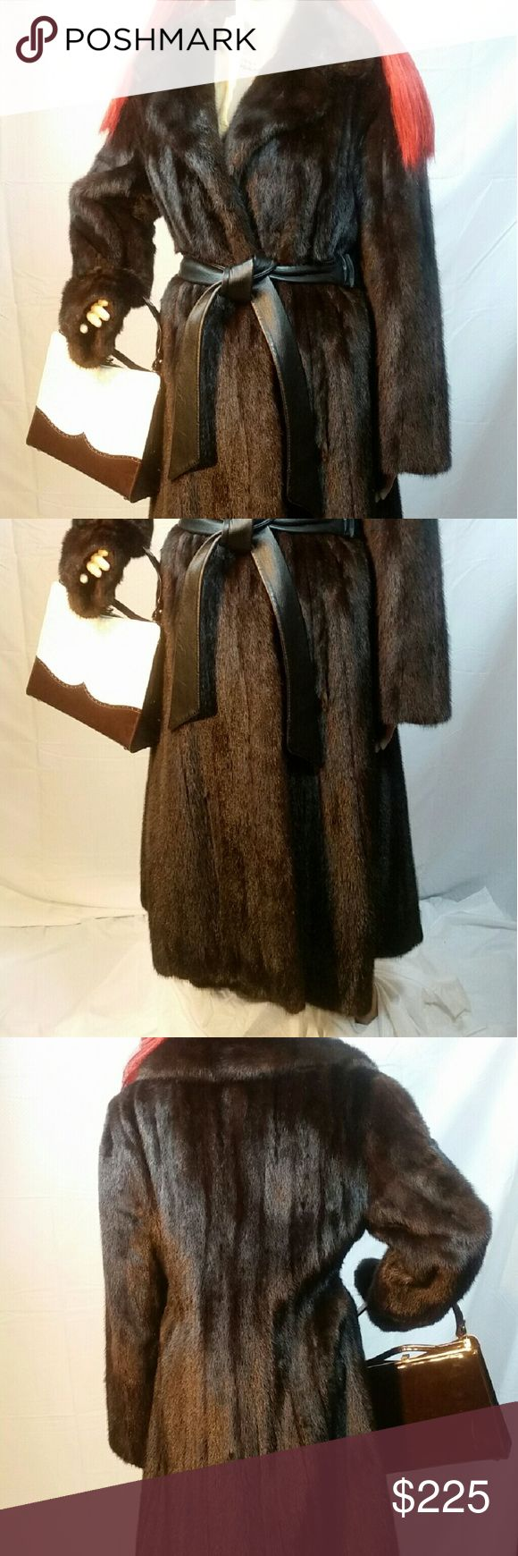 Black Mink Coat Full Length Size M CUSTOM MADE This beautiful black custom-made full length mink coat features a leather belt with elastic in the back. There is very little to any wear on this coat. We will go over it and make sure there are no loose threads or other flaws and will fix them before shipment. This coat is not a vintage coat. There are no antique musty smells. Measurements shoulders 17 collar2hem 45 bust 41 hips 43 sleeve 21.5 sweep 74. PRICE IS FIRM. NO TRADES. FANCY THAT…
