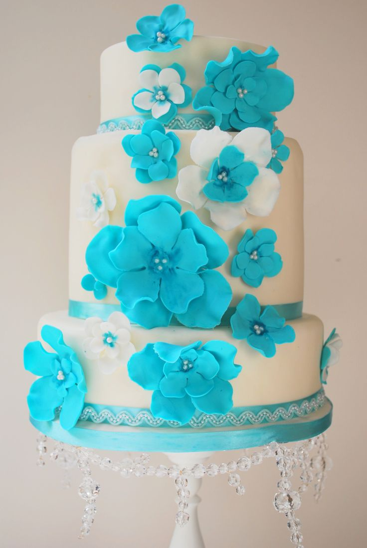3 tier white wedding cake with summery blue flower detail