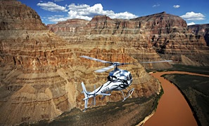 Experience affordable 1st Class VIP helicopter tours to Grand Canyon West Rim with 5 Star Grand Canyon Helicopter Tours in a one-of-kind VIP configured aircraft. Tours include spectacular aerial views of the Hoover Dam, Bypass Bridge and 180 degree panoramic views below the rim of the Grand Canyon.