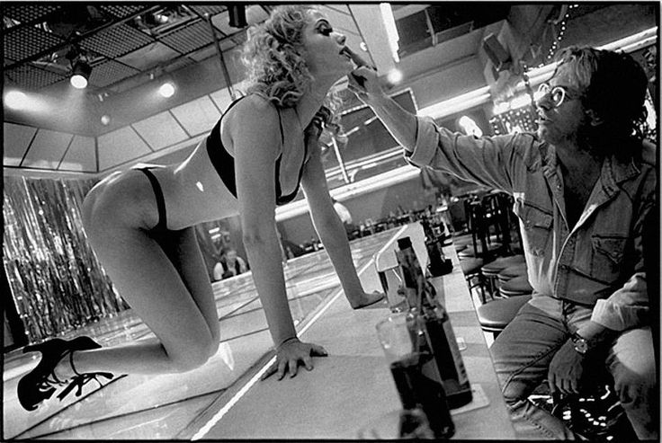 Paul Verhoeven adjusts Elizabeth Berkley's make-up, Showgirls, Los Angeles, California 1995