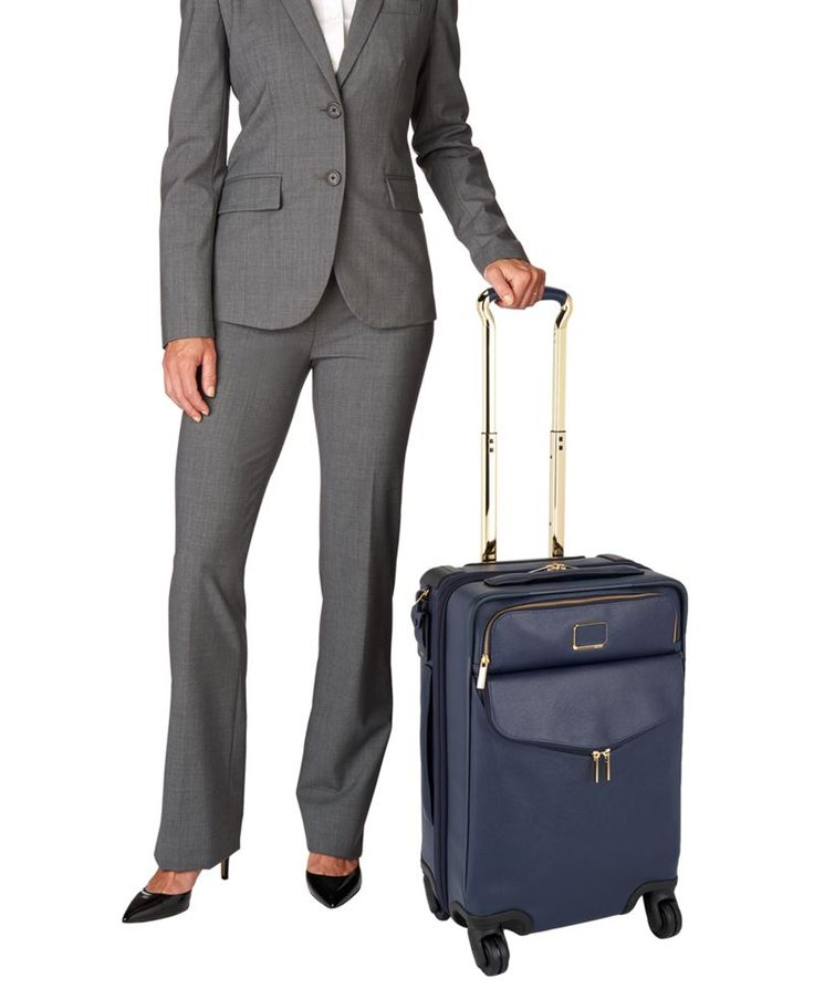 Sophisticated. Simple. Elegantly detailed. Sinclair is a modern collection of thoughtfully designed professional totes, briefs and carry-alls for women. This convenient, compact wheeled case is designed to meet the carry-on size requirements for travel within Europe and Asia. Also ideal for 1-2 day domestic trips. Impeccably crafted from the inside out, it features a retractable telescoping handle, smooth-rolling, recessed wheels and a spacious front pocket for easy access to small…