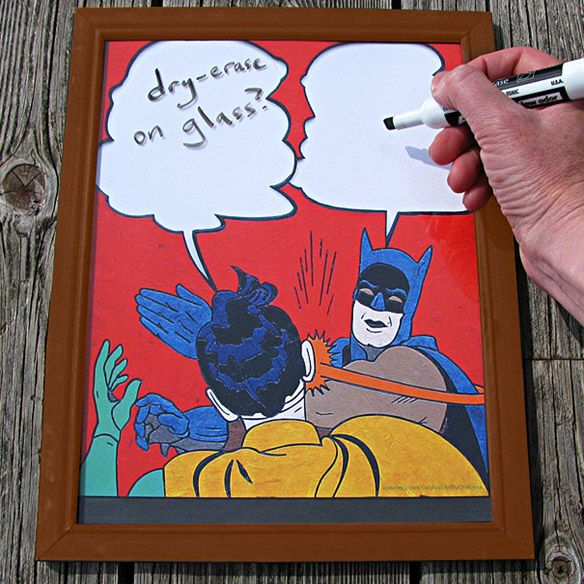 """If you've spent any time at all online, you've probably seen the meme around with Batman slapping the snot out of Robin. The Batman Slap Meme Dry-Erase White Board lets you add the words as the Caped Crusader continues his abuse of the Boy Wonder.  This 9.5""""W x 12""""H piece o"""