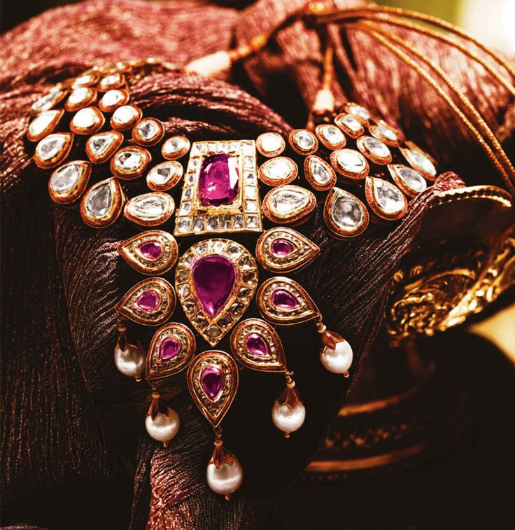 Crafted from handmade gold and uncut diamonds, Tanishq Kundan Polki necklace with rubies and pearls.
