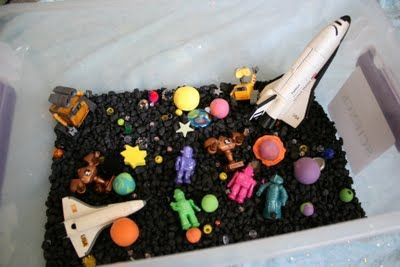 Great space sensory box from Pink and Green Mama. For my toddler. Reminder to myself: we already have black fish tank gravel in basement.