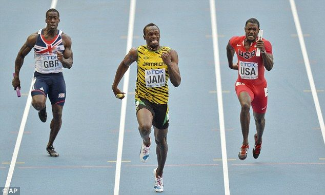 Ahead: Bolt holds the world record for 100m with 9.58 seconds