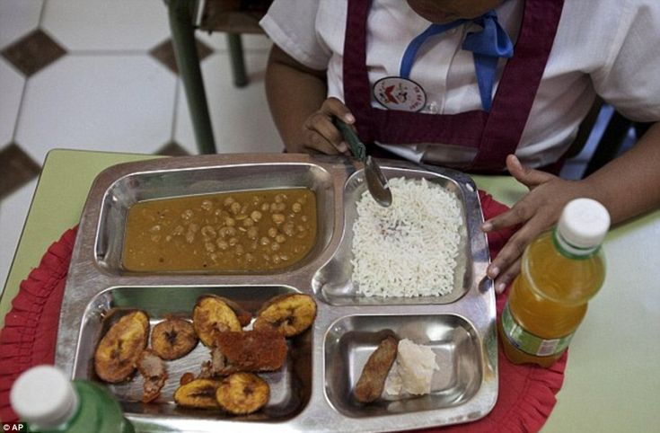 Rice, a chicken croquette, a piece of taro root and yellow pea soup is the school lunch in Old Havana, Cuba