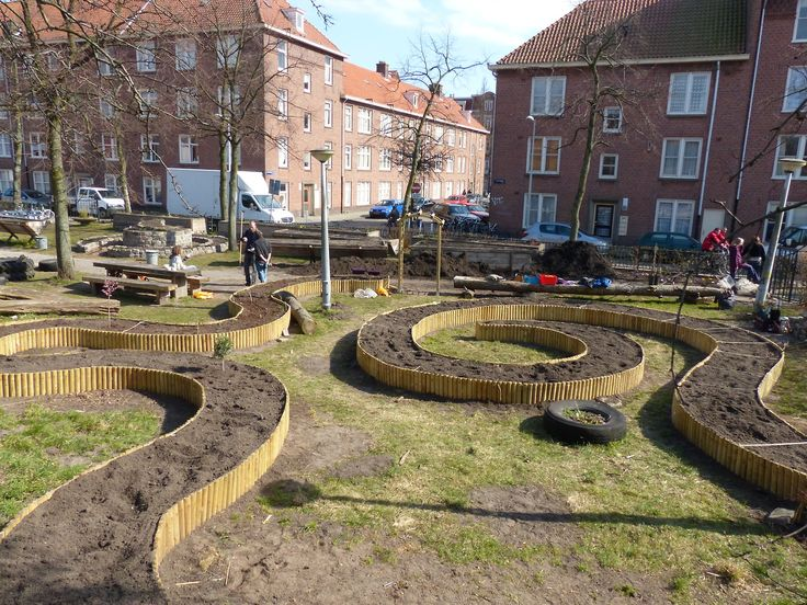 A community garden in Amsterdam with raised beds all around.