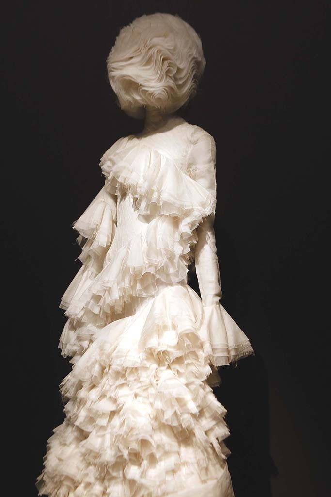 """A view of the """"Alexander McQueen: Savage Beauty"""" exhibit at the Metropolitan Museum of Art. [Photo by John Aquino]"""