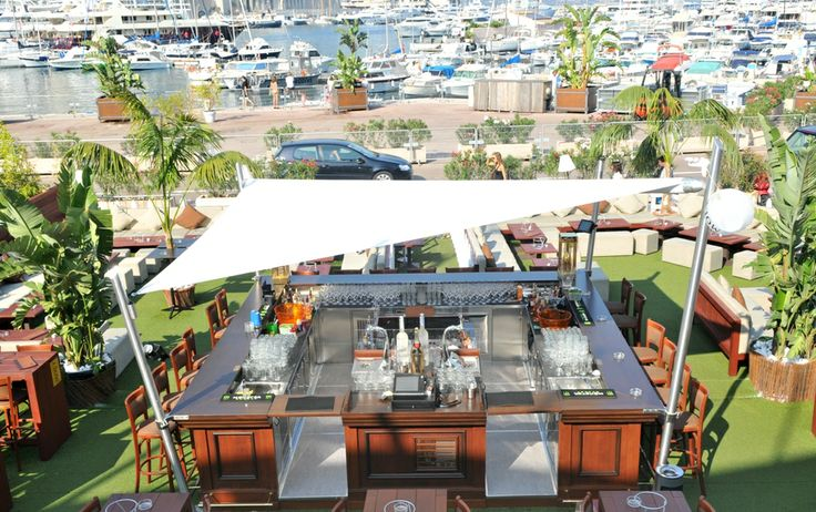 Intrepid - beautiful retractable sail awnings, designed and manufactured in Italy, derived from genuine nautical technology. For private and commercial spaces. A quayside pub in Monte Carlo.