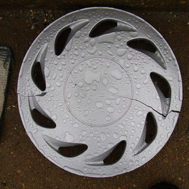 Get great results painting plastic hubcaps using automotive spray paint.