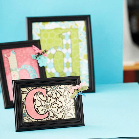 Patterned paper and a frame.  Cut a piece of paper to fit the frame opening.  Die-cut an oversize monogram.  Mount the intial to the paper with adhesive foam, add the mat.