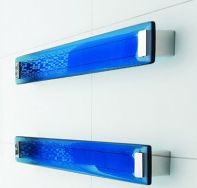 DC Short Lava Blue Heated Towel Rail The gently curved face of the Lava glass panels catch the light and look stunning in any style of bathroom. Available in a single width of 650mm. Specs: H 75 x W x 650 x D 70mm.