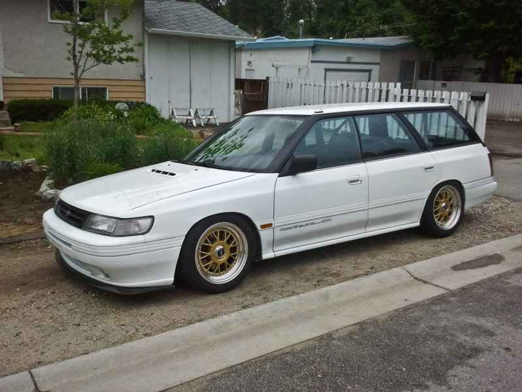 First Gen Subaru Legacy Wagon - BF body.  SS Sedan type front bumper, turbo hood.  Super bitchin, done factory parts style, heavily slammed, old school rims.