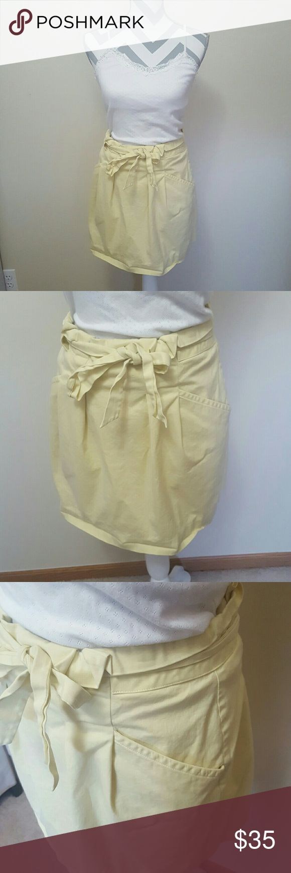 """BCBG Maxazria Yellow Tulip Paperbag Skirt Price Reduced! BCBG Maxazria brand in a size 8. This is a gorgeous pleated skirt for the warmer months. The skirt is a high waisted """"paperbag"""" style and includes a matching belt and pockets! Smoke free home and fast shipping. Thank you for checking out my closet BCBGMaxAzria Skirts"""
