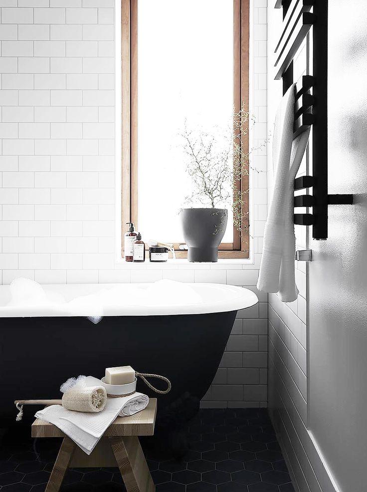 This bathroom is gorgeous! I love black bathtubs. They look so sleek!