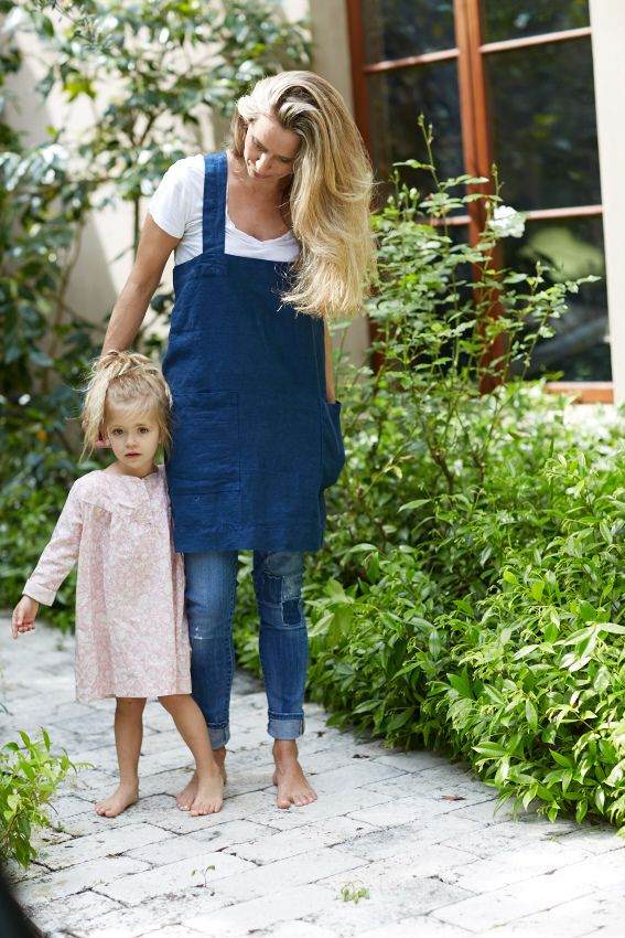 Rough Linen - 100% Linen Pinafore. Our signature cross-back apron with pockets, shown in Indigo, petite.